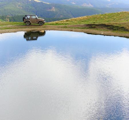 15644531 - vehicle for extreme terrain near lake icoana, suhard mountains, romania